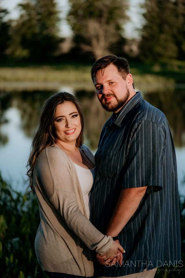 Formal portrait of future Ottawa bride and groom at Petrie Island during engagement session at Sunset.