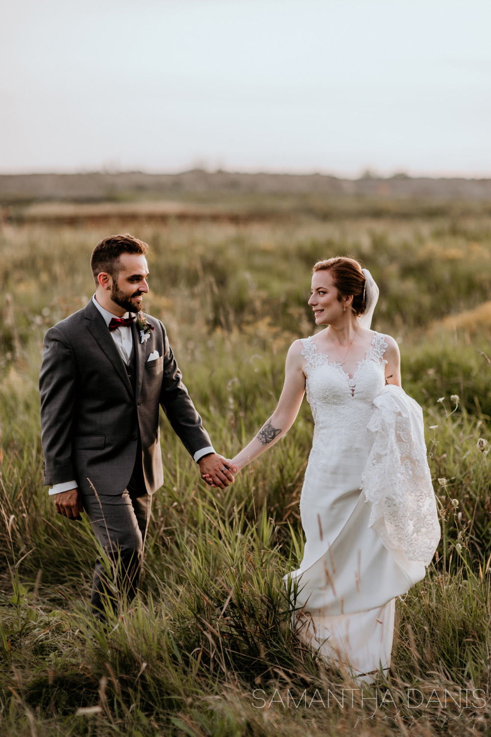 Ottawa Bride leads her new Husband through a golden field during sunset, Happiness is the goal and we got it! Samantha Danis Photography.