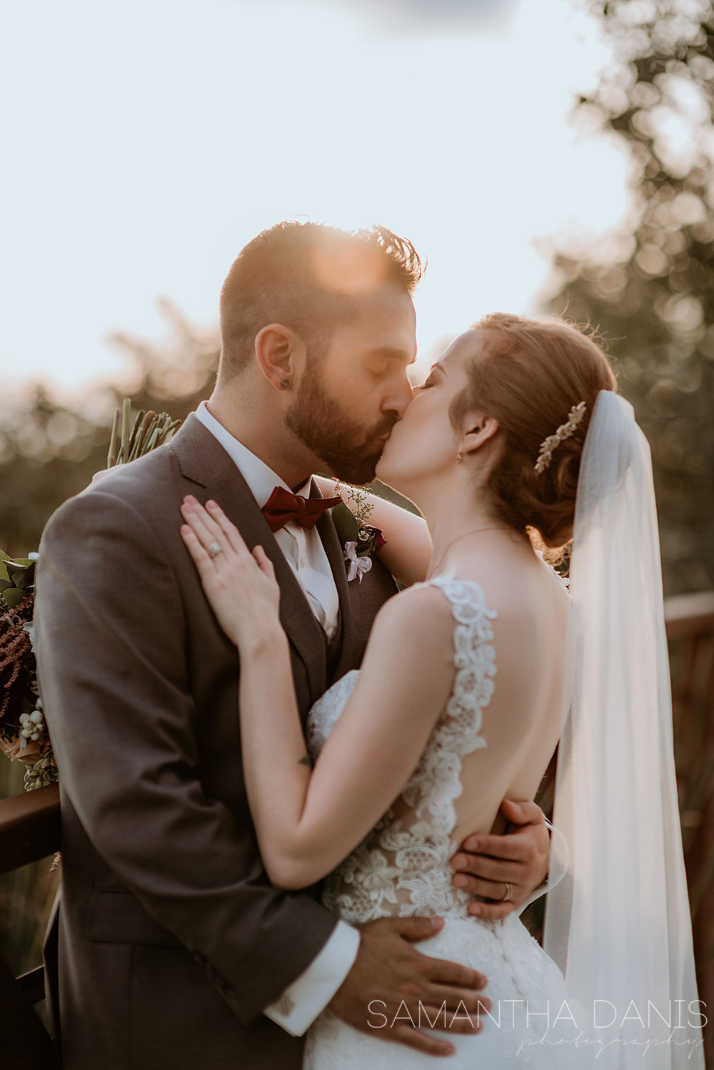 When the light is just right, the groom takes his wife and kisses her passionately.