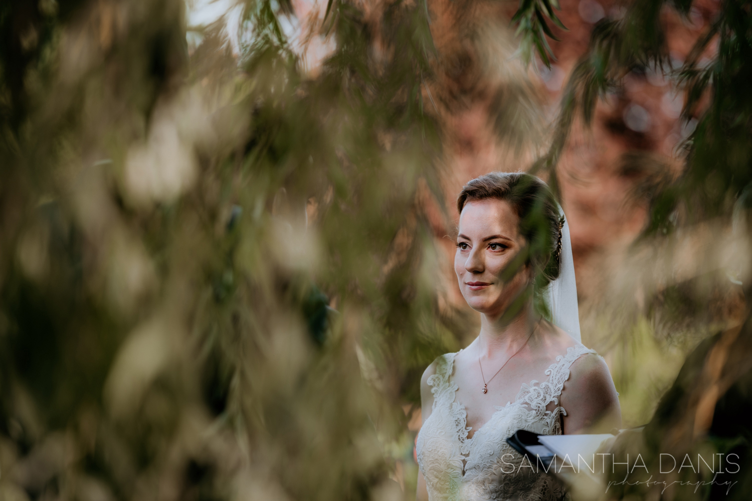 Photographed through the willow leaves and framing our Ottawa Brides face perfectly during their elopement ceremony.