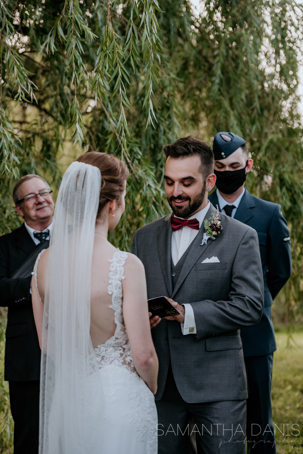 L'Escale music teacher reciting his vows to his soon to be bride. Ceremony held in Walter Baker Park Kanata, Ontario